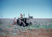 56 The John Deer Tractor plowing